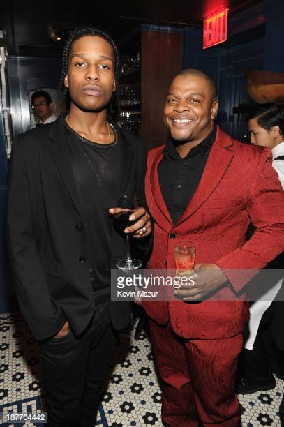Rapper ASAP Rocky and artist Kehinde Wiley attend the GQ Men of the Year dinner on November 11, 2013 in New York City.