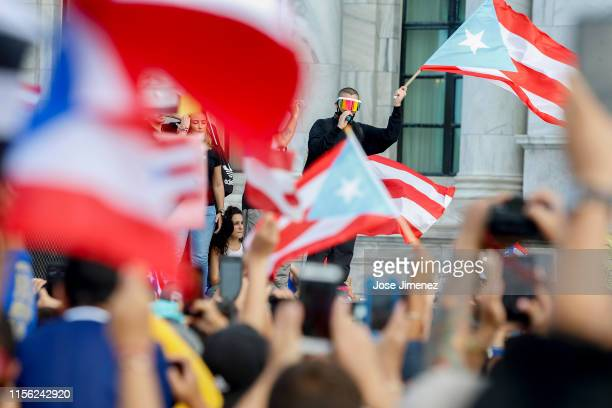Rapper Bad Bunny as he joined thousands of demonstrators protesting against Ricardo Rossello the Governor of Puerto Rico July 17 2019 in front of the...