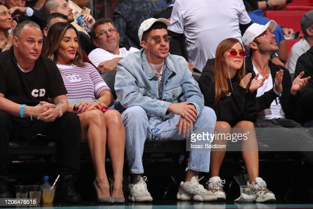 Rapper Bad Bunny attends the game between the Miami Heat and the Dallas Mavericks on February 28 2020 at American Airlines Arena in Miami Florida...