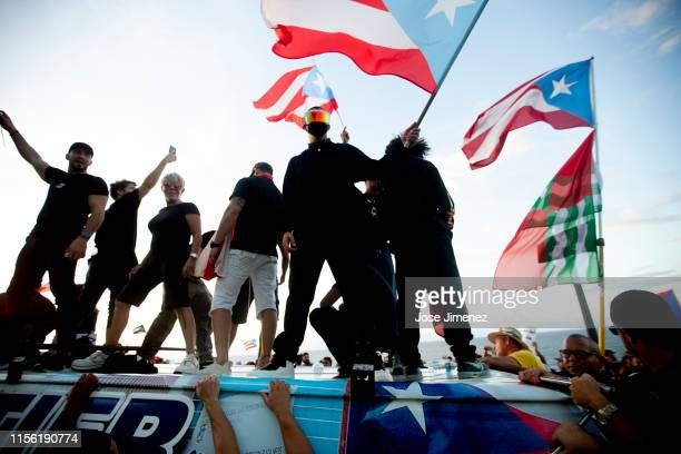 Rapper Bad Bunny joins thousands of demonstrators protesting against Ricardo Rossello the Governor of Puerto Rico in front of the Capitol Building on...