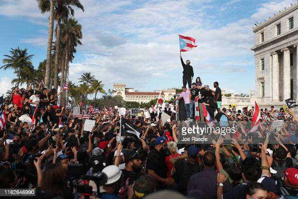Rapper Bad Bunny singer Ricky Martin and Rapper Residente join demonstrators protesting against Ricardo Rossello the Governor of Puerto Rico July 17...