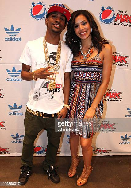 Rapper Big Sean and Julissa Bermudez attend the Pepsi Max Foo Fighters event at the Adidas Originals Store on July 25 2011 in New York City