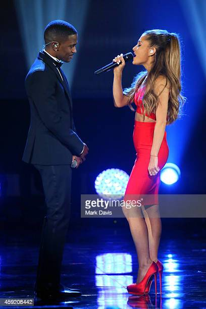 Rapper Big Sean and singer Ariana Grande perform onstage during A VERY GRAMMY CHRISTMAS at The Shrine Auditorium on November 18 2014 in Los Angeles...