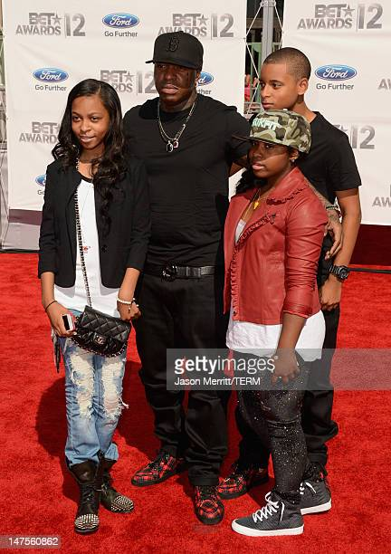 Rapper Birdman and family arrive at the 2012 BET Awards at The Shrine Auditorium on July 1 2012 in Los Angeles California