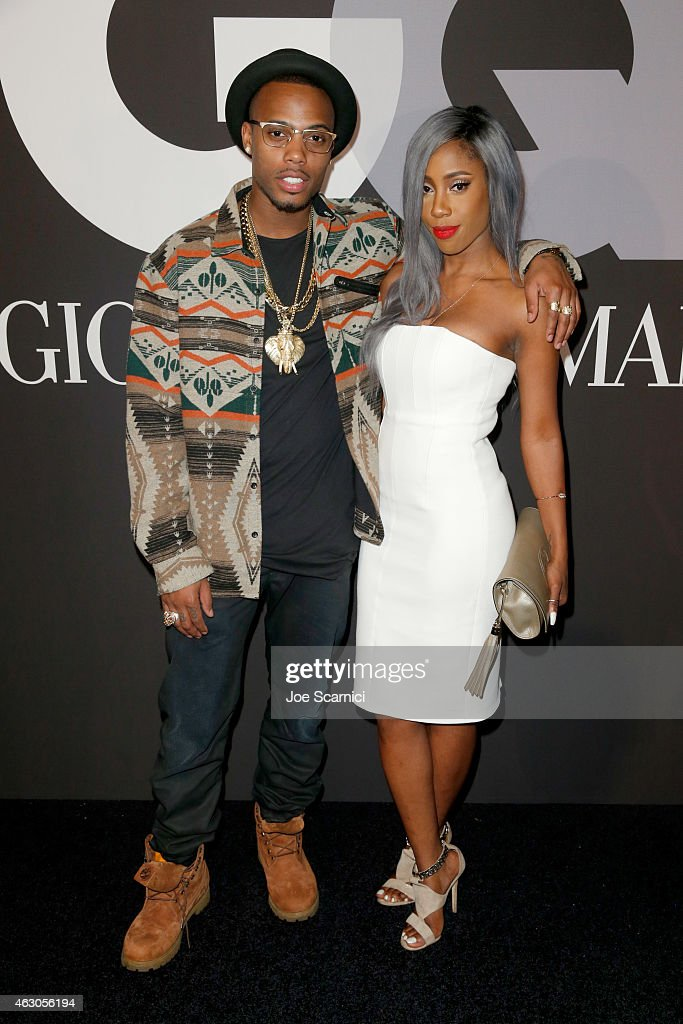 Rapper B.o.B (L) and singer Sevyn Streeter attend GQ and Giorgio Armani Grammys After Party at Hollywood Athletic Club on February 8, 2015 in Hollywood, California.