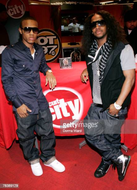 Rapper Bow Wow and singer Omarion pose before signing their new CD FACE OFF at Circuit City on December 11 2007 in New York City