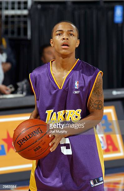 Rapper Bow Wow shoots during the Celebrity Shootout at Jam Session on February 14 2004 at the Los Angeles Convention Center in Los Angeles California...