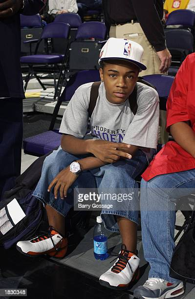 Rapper Bow Wow sits courtside as he poses for a photo during the game between the Boston Celtics and the Phoenix Suns at America West Arena on...
