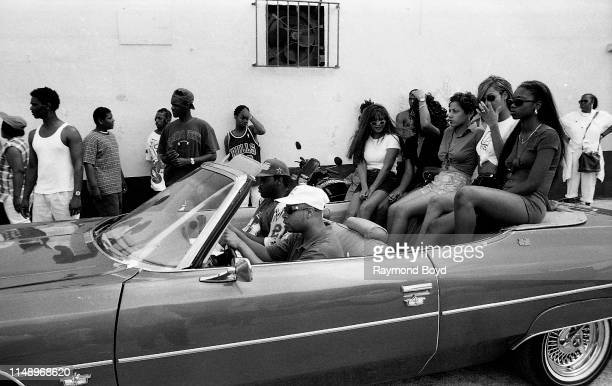Rapper Brother Marquis from 2 Live Crew gets ready for a 'driving scene' while on the set of their video 'Shake A Lil Somethin'' in Liberty City in...
