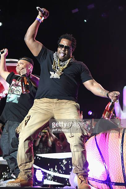 Rapper Busta Rhymes performs onstage with Girl Talk during day 1 of the 2014 Coachella Valley Music Arts Festival at the Empire Polo Club on April 11...