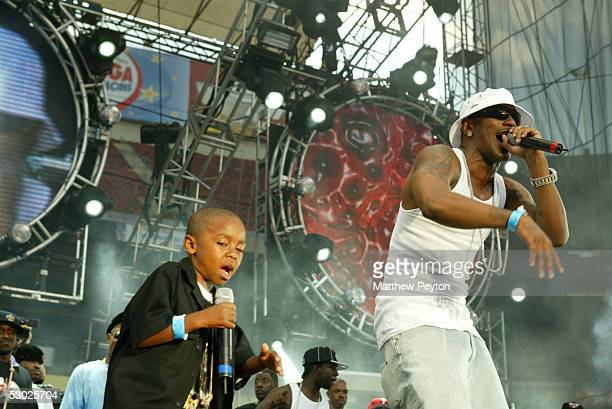 Rapper Cam'ron and his son perform at the Hot 97 Summer Jam 2005 Concert June 5 2005 at Giant Stadium in East Rutherford New Jersey