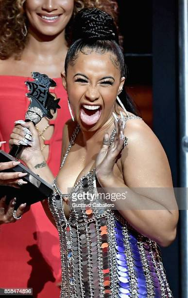 Rapper Cardi B accepts the award for 'Best New Hip Hop Artist' onstage during the BET Hip Hop Awards 2017 at The Fillmore Miami Beach at the Jackie...