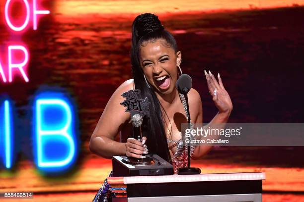 Rapper Cardi B accepts the award for 'Hustler of the Year' onstage during the BET Hip Hop Awards 2017 at The Fillmore Miami Beach at the Jackie...