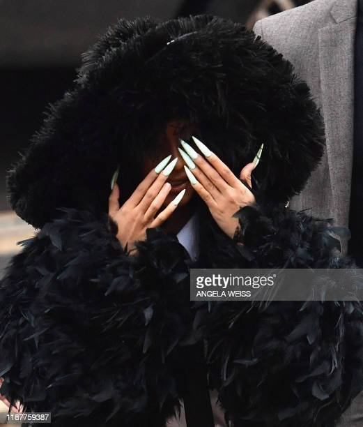 TOPSHOT Rapper Cardi B arrives for her court hearing at Queens Criminal Court on December 10 2019 in New York City