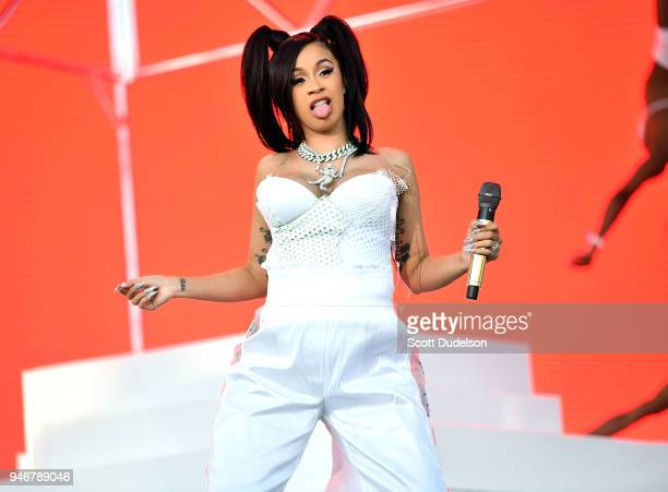 Rapper Cardi B performs on the Coachella stage during week 1 day 3 of the Coachella Valley Music and Arts Festival on April 15 2018 in Indio...