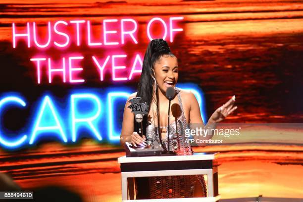 Rapper Cardi B receives the award for Hustler of the Year during the BET Hip Hop Awards 2017 at The Fillmore Miami Beach at the Jackie Gleason...