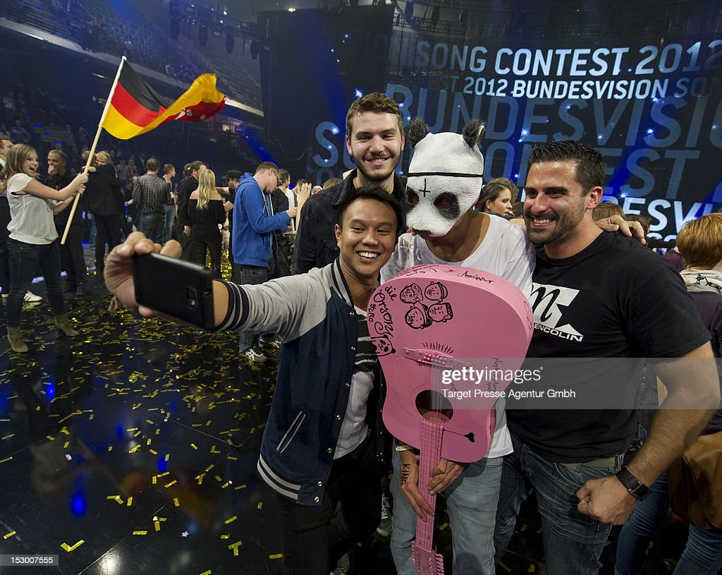 Rapper Carlo Waibel aka Cro poses together with fans after the 'Bundesvision Song Contest 2012' at the Max-Schmeling-Halle on September 28, 2012 in Berlin, Germany.