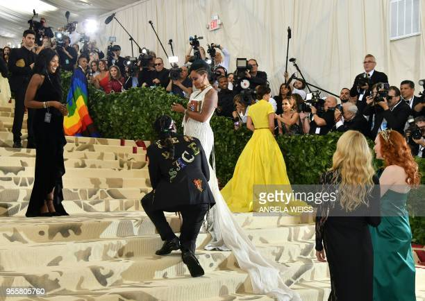 Rapper Chainz proposes to his wife Kesha Ward as they arrive for the 2018 Met Gala on May 7 at the Metropolitan Museum of Art in New York The Gala...