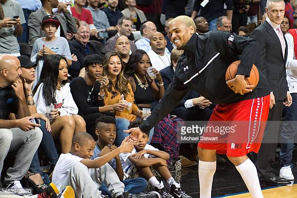 Rapper Chris Brown and singer Rihanna attend the 2014 Summer Classic Charity Basketball Game at Barclays Center on August 21 2014 in New York City