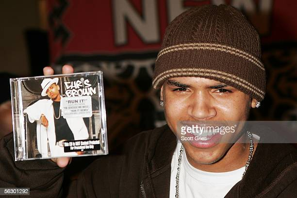 Rapper Chris Brown poses for a photo at the Virgin Megastore in Times Square November 29 2005 in New York City