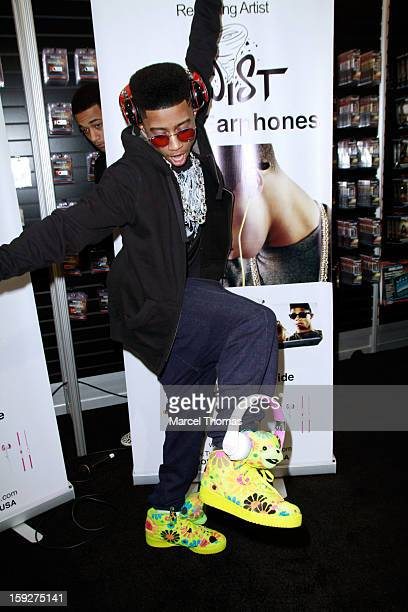 Rapper Christopher Lil Twist Moore attends a meet and greet at the Nikura Electronics booth during the 2013 International CES at the Las Vegas...