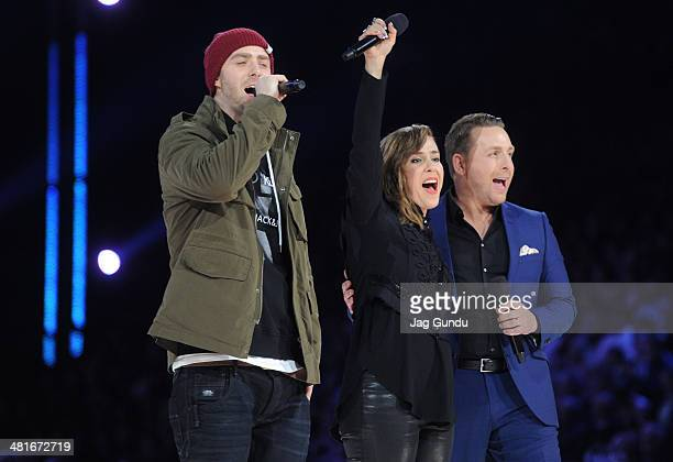 Rapper Classified singer Serena Ryder and host Johnny Reid perform on stage at the2014 Juno Awards held at the MTS Centre on March 30 2014 in...
