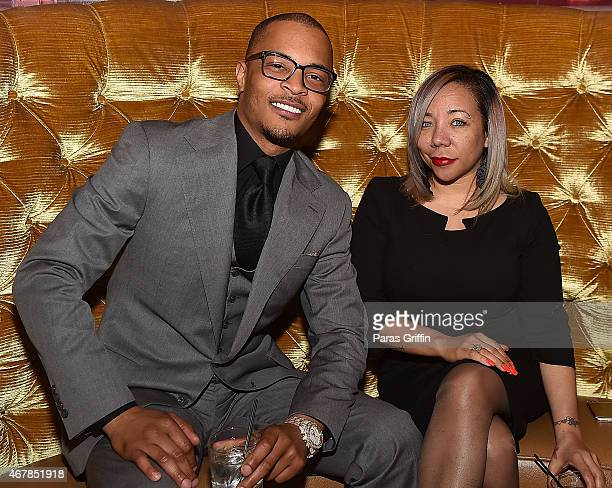 Rapper Clifford TI Harris and Tameka Tiny Harris attend Scales 925 Restaurant Ribbon Cutting Ceremony at Scales 925 Restaurant on March 27 2015 in...