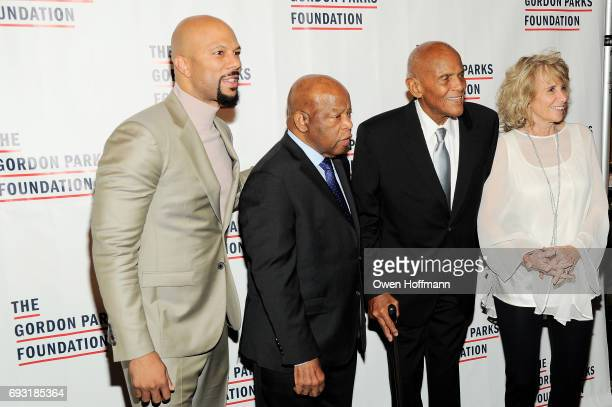 Rapper Common Congressman John Lewis singer Harry Belafonte and photographer Pamela Frank attend the Gordon Parks Foundation Awards Dinner Auction at...