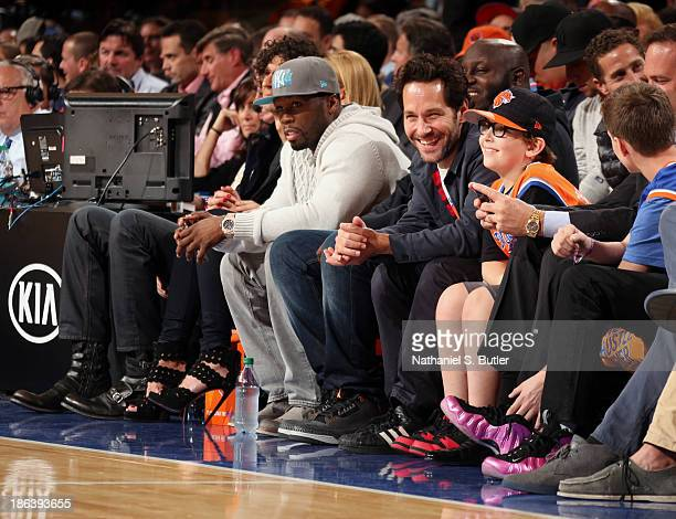 Rapper Curtis James Jackson III better known by his stage name 50 Cent sits beside a laughing Paul Rudd famous actor and comedian as they watch the...