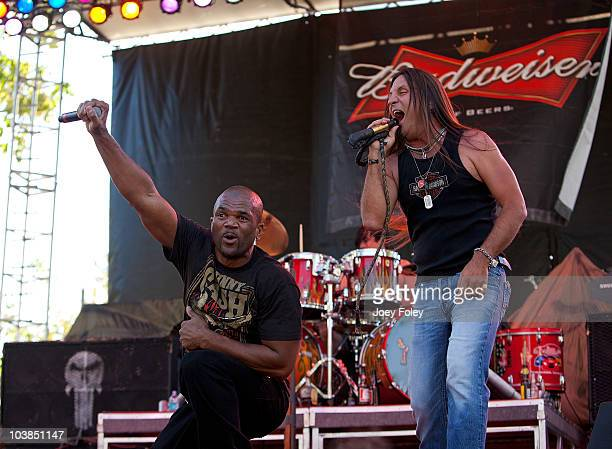 Rapper Darryl DMC McDaniels joins Jesse James Dupree of the rock band Jackyl onstage for three songs during the 15th Annual Rib America Festival Day...