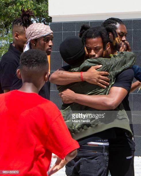 Rapper Denzel Curry hugs a fan outside the BBT Center before the memorial service for fellow slain rapper XXXTentacion in Sunrise Fla on Wednesday...