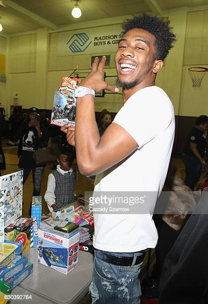 Rapper Desiigner makes a surprise holiday visit to the Boys and Girls Club in the borough of Brooklyn on December 21 2016 in New York City
