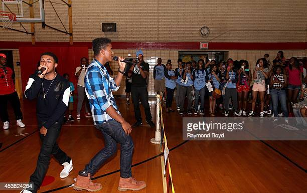 Rapper Diggy Simmons and singer and actor Trevor Jackson performs their single My Girl at the Foster Park Fieldhouse on August 9 2014 in Chicago...
