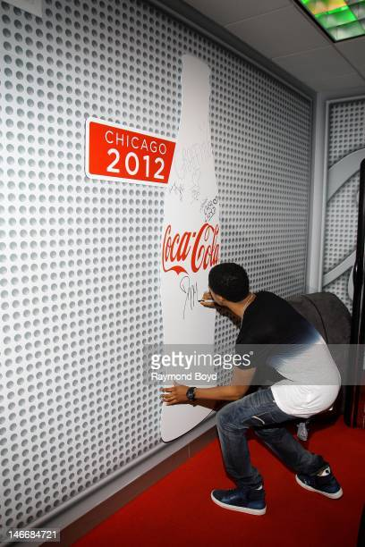 Rapper Diggy Simmons autographs the CocaCola wall in the WGCIFM CocaCola Lounge in Chicago Illinois on JUNE 20 2012