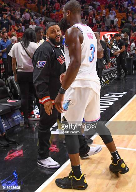 Rapper DJ Khaled greets Dwyane Wade of the Miami Heat after the game between the Miami Heat and the Oklahoma City Thunder at American Airlines Arena...