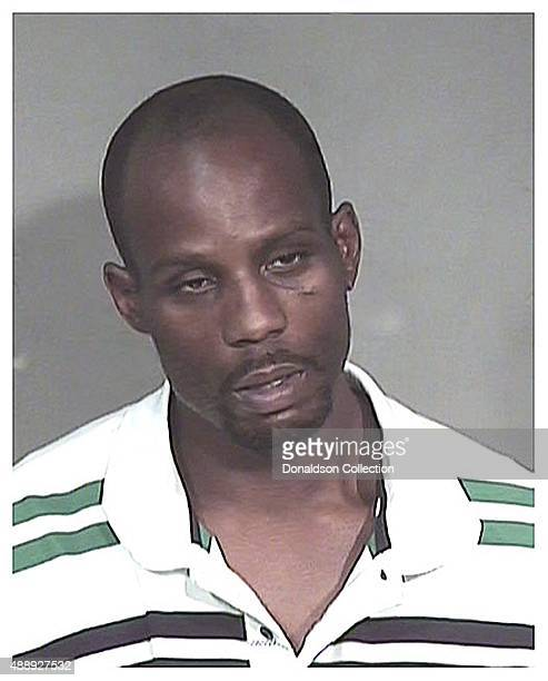 Rapper DMX poses for a mugshot at the Maricopa County Jail after his arrest for animal cruelty and drug possession on May 9 2008 in Phoenix Arizona
