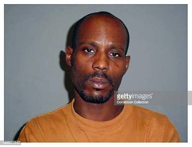 Rapper DMX poses for a mugshot at the Scottsdale City Jail after his arrest for speeding and driving on a suspended license in May 2008 in Scottsdale...