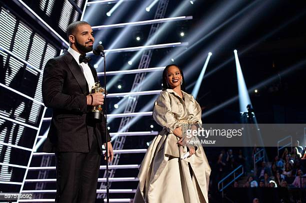 Rapper Drake and singer Rihanna speak onstage during the 2016 MTV Video Music Awards at Madison Square Garden on August 28 2016 in New York City