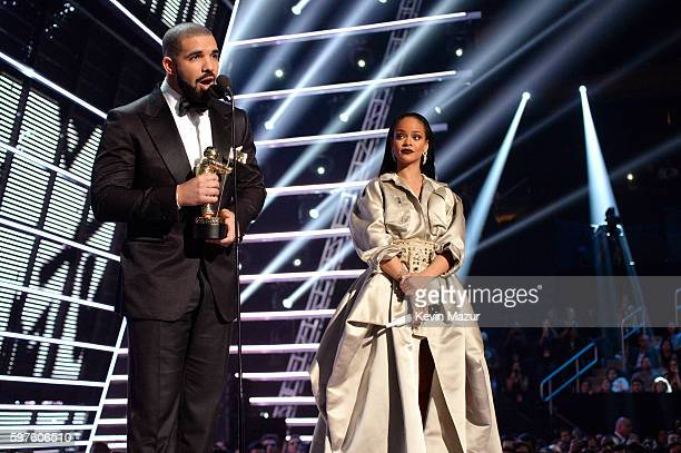 Rapper Drake and singer Rihanna speak onstage during the 2016 MTV Music Video Awards at Madison Square Garden on August 28 2016 in New York City