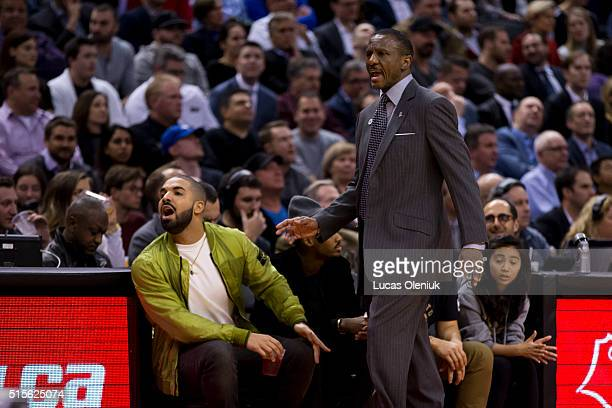 Rapper Drake and Toronto coach Dwayne Casey yell at the referee after a contentious foul in the second quarter The Toronto Raptors hosted the Chicago...