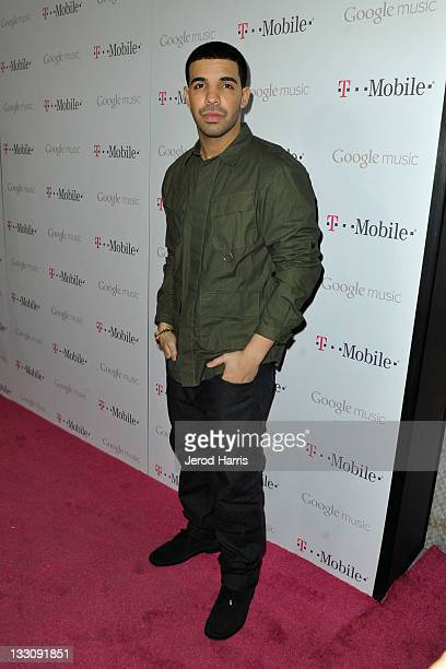 Rapper Drake arrives on the TMobile magenta carpet for the launch of Google Music hosted by TMobile at Mr Brainwash Studio on November 16 2011 in Los...