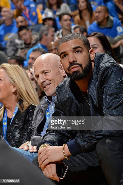 Rapper Drake attends the San Antonio Spurs game against the Golden State Warriors on January 25 2016 at Oracle Arena in Oakland California NOTE TO...