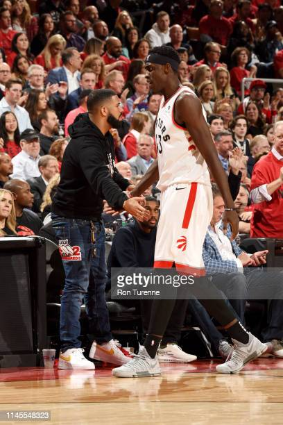 Rapper Drake hifives Pascal Siakam of the Toronto Raptors during the game against Milwaukee Bucks during Game Four of the Eastern Conference Finals...
