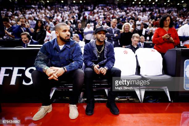 Rapper, Drake is seen at the game between the Toronto Raptors and the Cleveland Cavaliers in Game Three of the Eastern Conference Semifinals during...