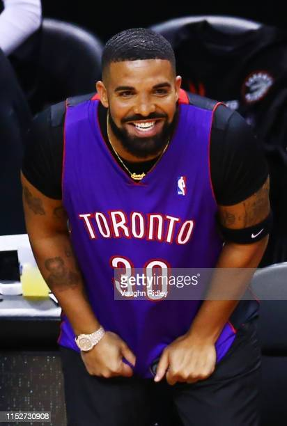 Rapper Drake is seen wearing a Dell Curry jersey before Game One of the 2019 NBA Finals between the Golden State Warriors and the Toronto Raptors at...