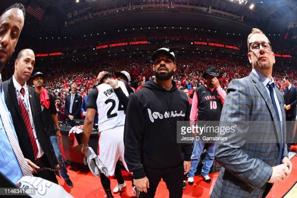 Rapper Drake looks on after a game between the Milwaukee Bucks and the Toronto Raptors after Game Six of the Eastern Conference Finals on May 25 2019...