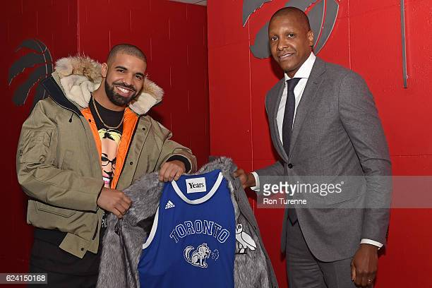 Rapper Drake poses for a photo with the President of the Toronto Raptors Masai Ujiri before the Golden State Warriors game on November 16 2016 at the...