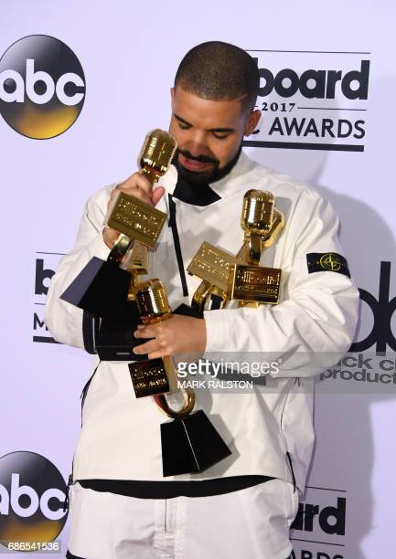 Rapper Drake poses in the press room with his awards during the 2017 Billboard Music Awards at the TMobile Arena on May 21 2017 in Las Vegas Nevada...