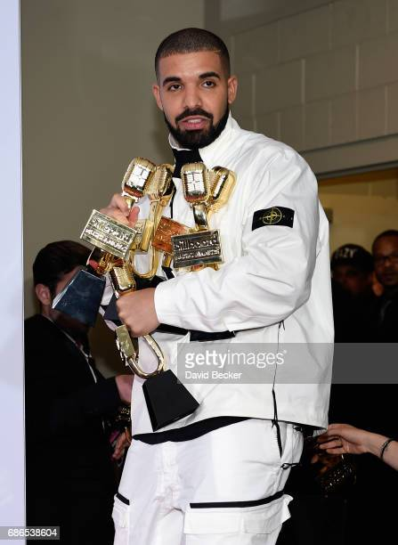 Rapper Drake poses in the press room with his awards for Top Artist Top Male Artist Top Billboard 200 Artist Top Billboard 200 Album for 'Views' Top...