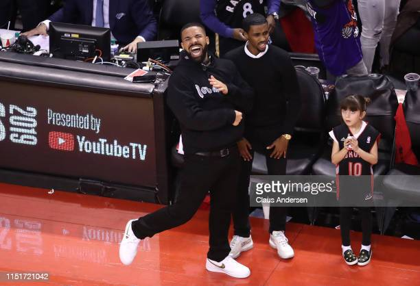 Rapper Drake reacts after the Toronto Raptors defeated the Milwaukee Bucks 100-94 in game six of the NBA Eastern Conference Finals to advance to the...